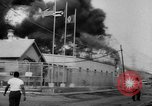 Image of Oil company warehouse under fire San Juan Puerto Rico, 1967, second 10 stock footage video 65675043046