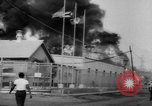 Image of Oil company warehouse under fire San Juan Puerto Rico, 1967, second 11 stock footage video 65675043046