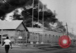 Image of Oil company warehouse under fire San Juan Puerto Rico, 1967, second 12 stock footage video 65675043046