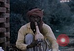 Image of Snake charmer India, 1956, second 2 stock footage video 65675043054