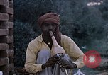 Image of Snake charmer India, 1956, second 3 stock footage video 65675043054
