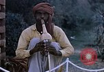 Image of Snake charmer India, 1956, second 5 stock footage video 65675043054