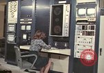 Image of Woman operates computer controls New Mexico United States USA, 1975, second 1 stock footage video 65675043084