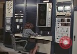 Image of Woman operates computer controls New Mexico United States USA, 1975, second 2 stock footage video 65675043084