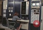 Image of Woman operates computer controls New Mexico United States USA, 1975, second 3 stock footage video 65675043084