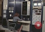 Image of Woman operates computer controls New Mexico United States USA, 1975, second 4 stock footage video 65675043084