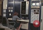 Image of Woman operates computer controls New Mexico United States USA, 1975, second 10 stock footage video 65675043084