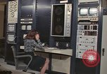 Image of Woman operates computer controls New Mexico United States USA, 1975, second 12 stock footage video 65675043084