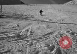 Image of ski patrolmen rescue skier Garmisch-Partenkirchen Germany, 1965, second 2 stock footage video 65675043203
