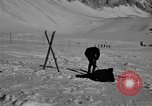 Image of Ski patrol personnel Garmisch-Partenkirchen Germany, 1965, second 2 stock footage video 65675043207