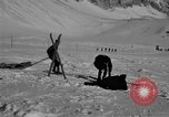 Image of Ski patrol personnel Garmisch-Partenkirchen Germany, 1965, second 4 stock footage video 65675043207