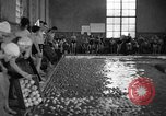 Image of Apple bobbing Seattle Washington USA, 1938, second 12 stock footage video 65675043245