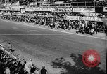 Image of 24 hours motorcycle race Spain, 1964, second 7 stock footage video 65675043300