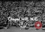 Image of Football match Chapel Hill North Carolina USA, 1955, second 1 stock footage video 65675043382