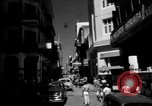 Image of Narrow crowded commercial street Puerto Rico, 1950, second 1 stock footage video 65675043413
