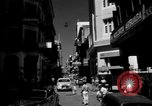 Image of Narrow crowded commercial street Puerto Rico, 1950, second 3 stock footage video 65675043413