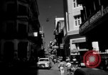 Image of Narrow crowded commercial street Puerto Rico, 1950, second 5 stock footage video 65675043413