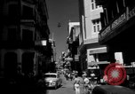 Image of Narrow crowded commercial street Puerto Rico, 1950, second 6 stock footage video 65675043413