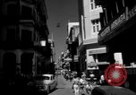Image of Narrow crowded commercial street Puerto Rico, 1950, second 7 stock footage video 65675043413