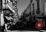 Image of Narrow crowded commercial street Puerto Rico, 1950, second 11 stock footage video 65675043413