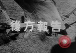 Image of modified tank to pull plow Europe, 1940, second 9 stock footage video 65675043469
