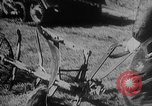 Image of modified tank to pull plow Europe, 1940, second 12 stock footage video 65675043469