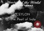 Image of natives in town Ceylon, 1937, second 3 stock footage video 65675043493
