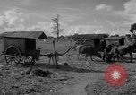 Image of Bullock cart dwellers Phnom Penh Cambodia, 1957, second 8 stock footage video 65675043579
