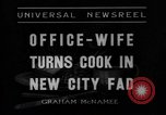 Image of Office wife turns cook Chicago Illinois USA, 1936, second 3 stock footage video 65675043759