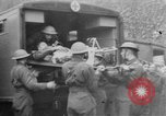 Image of wounded British soldier on stretcher United Kingdom, 1940, second 1 stock footage video 65675043882