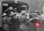 Image of wounded British soldier on stretcher United Kingdom, 1940, second 4 stock footage video 65675043882