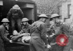 Image of wounded British soldier on stretcher United Kingdom, 1940, second 7 stock footage video 65675043882