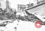 Image of damaged building Anchorage Alaska USA, 1964, second 2 stock footage video 65675044024
