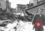 Image of damaged building Anchorage Alaska USA, 1964, second 10 stock footage video 65675044024