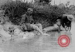 Image of Ho Chi Minh washes his feet Vietnam, 1942, second 8 stock footage video 65675044086