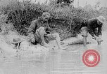 Image of Ho Chi Minh washes his feet Vietnam, 1942, second 9 stock footage video 65675044086
