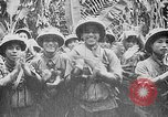 Image of Ho Chi Minh rides pony on jungle trail Vietnam, 1942, second 12 stock footage video 65675044087