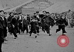 Image of Vietnamese children run to see event Vietnam, 1954, second 2 stock footage video 65675044095