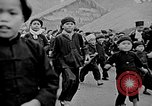Image of Vietnamese children run to see event Vietnam, 1954, second 3 stock footage video 65675044095