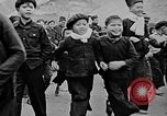 Image of Vietnamese children run to see event Vietnam, 1954, second 6 stock footage video 65675044095