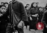 Image of Vietnamese children run to see event Vietnam, 1954, second 9 stock footage video 65675044095