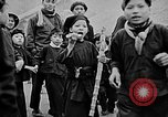 Image of Vietnamese children run to see event Vietnam, 1954, second 11 stock footage video 65675044095