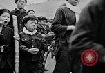 Image of Vietnamese children run to see event Vietnam, 1954, second 12 stock footage video 65675044095