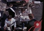 Image of people read newspaper New York United States USA, 1964, second 9 stock footage video 65675044257