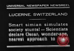 Image of Chimpanzee Oscar dining at table Lucerne Switzerland, 1930, second 1 stock footage video 65675044386
