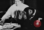 Image of Chimpanzee Oscar dining at table Lucerne Switzerland, 1930, second 2 stock footage video 65675044386