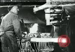 Image of Forging in a steel mill Europe, 1918, second 1 stock footage video 65675044430