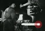 Image of Forging in a steel mill Europe, 1918, second 2 stock footage video 65675044430