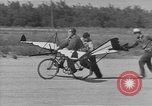 Image of Man attempts to fly a bicycle United States, 1937, second 11 stock footage video 65675044877