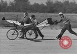 Image of Man attempts to fly a bicycle United States, 1937, second 12 stock footage video 65675044877